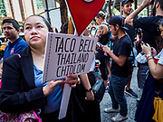 24 JANUARY 2019 - BANGKOK, THAILAND:  Hundreds of people wait in line to go to the first Taco Bell in Thailand. The Taco Bell  opened Thursday. The restaurant has a 215 square meter space in Mercury Ville, a mixed use retail/office building in central Bangkok. Taco Bell is owned by Yum Brands, which also owns KFC, Pizza Hut, and WingStreet. Taco Bell in Thailand joins KFC, which has more than 500 restaurants in Thailand and Pizza Hut, which recently started expanding in Thailand.   PHOTO BY JACK KURTZ