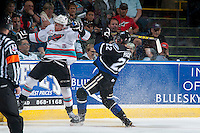KELOWNA, CANADA - APRIL 17: Rodney Southam #17 of Kelowna Rockets checks Brayden Pachal #22 of Victoria Royals during the first period  on April 17, 2016 at Prospera Place in Kelowna, British Columbia, Canada.  (Photo by Marissa Baecker/Shoot the Breeze)  *** Local Caption *** Rodney Southam; Brayden Pachal;
