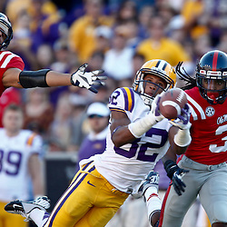 November 17, 2012; Baton Rouge, LA, USA;  LSU Tigers wide receiver James Wright (82) catches a pass over Ole Miss Rebels defensive back Cody Prewitt (25) and defensive back Charles Sawyer (3) during the first half of a game at Tiger Stadium.  Mandatory Credit: Derick E. Hingle-US PRESSWIRE