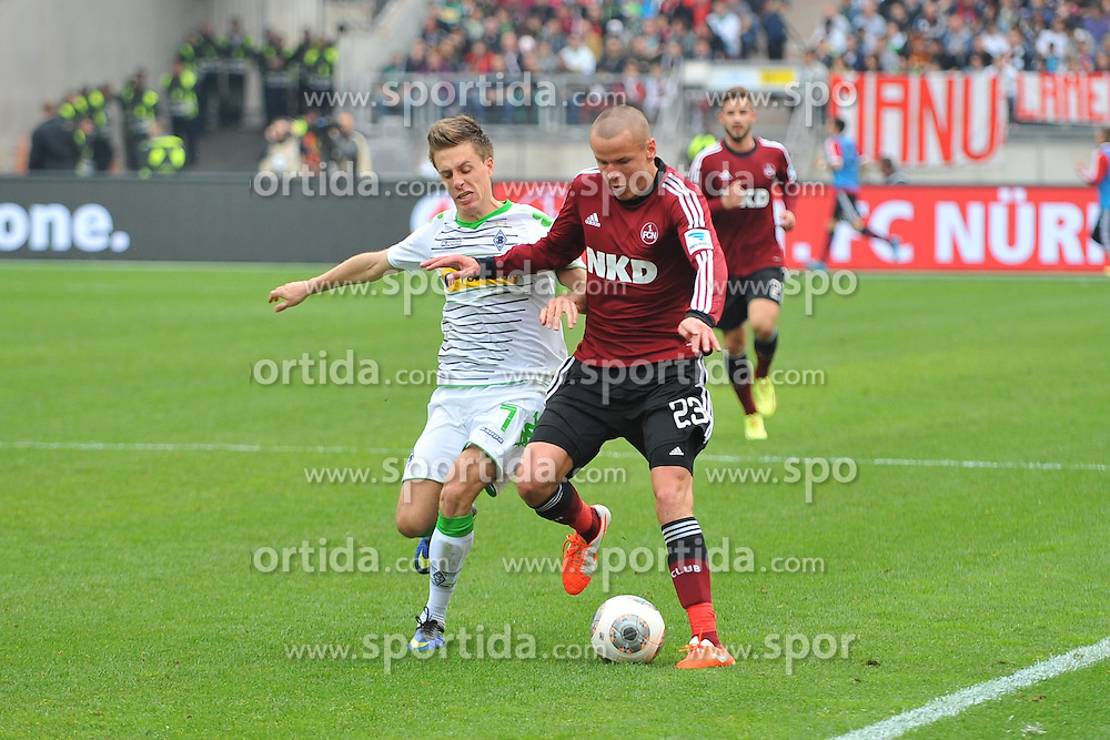05.04.2014, easyCredit Stadion, Nuernberg, GER, 1. FBL, 1. FC Nuernberg vs Borussia Moenchengladbach, 29. Runde, im Bild Adam Hlousek (1.FC Nuernberg / rechts) im Zweikampf mit Patrick Herrmann (Borussia Moenchengladbach / links). // during the German Bundesliga 29th round match between 1. FC Nuernberg and Borussia Moenchengladbach at the easyCredit Stadion in Nuernberg, Germany on 2014/04/05. EXPA Pictures &copy; 2014, PhotoCredit: EXPA/ Eibner-Pressefoto/ Merz<br /> <br /> *****ATTENTION - OUT of GER*****