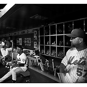 Yoenis Cespedes, (left), New York Mets, preparing to bat in the dugout with hitting coach Kevin Long, (right), during the New York Mets Vs Atlanta Braves MLB regular season baseball game at Citi Field, Queens, New York. USA. 22nd September 2015. Photo Tim Clayton