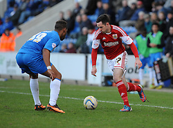 Bristol City's Greg Cunningham takes on Colchester United's Alie Sesay - Photo mandatory by-line: Dougie Allward/JMP - Mobile: 07966 386802 22/03/2014 - SPORT - FOOTBALL - Colchester - Colchester Community Stadium - Colchester United v Bristol City - Sky Bet League One