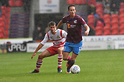 Scunthorpe United midfielder Josh Morris (11) and Doncaster Rovers midfielder Matty Blair (17)  during the EFL Sky Bet League 1 match between Doncaster Rovers and Scunthorpe United at the Keepmoat Stadium, Doncaster, England on 17 September 2017. Photo by Ian Lyall.