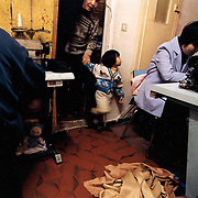France, Paris, 05-2003..Clandestine Chinese work at a garment sweat-shop in Paris. They are a new wave of immigrants from China?s northeast, home to millions of former cradle-to-grave factory workers laid off by closures. ..