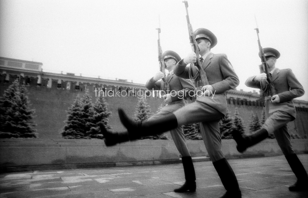 Guards walk in 'goose step' in front of the Kremlin, Moscow, Russia. From black and white infrared film.