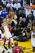 Golden State Warriors guard Stephen Curry (30) takes the ball to the basket against the Houston Rockets at Oracle Arena in Oakland, Calif., on October 17, 2017. (Stan Olszewski/Special to S.F. Examiner)