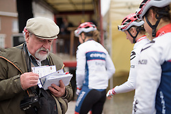 Autograph hunter searches for Pilote Fortin's rider card at Pajot Hills Classic 2017. A 121 km road race on March 29th 2017 in Gooik, Belgium. (Photo by Sean Robinson/Velofocus)