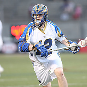Dean Gibbons #12 of the Charlotte Hounds is seen during the game at Harvard Stadium on May 17, 2014 in Boston, Massachuttes. (Photo by Elan Kawesch)