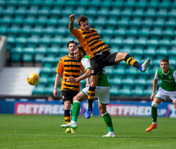 Alloa Athletic's Steven Hetherington and Hibernian's Christian Doidge. Half time : Hibernian 0 v 0 Alloa Athletic, Betfred Cup game played Saturday 20th July at Easter Road, Edinburgh.
