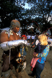 Stock photo of a large man talking to a little girl and her father at the Texas Renaissance Festival in Plantersville Texas
