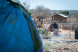27 January 2019, Burka Dare IDP site, near Micha, Seweyna woreda, Bale Zone, Oromia, Ethiopia: Internally displaced people live in small houses or huts, shared by up to eight households under a single roof. The Lutheran World Federation supports internally displaced people in several regions of Ethiopia, through emergency response on water, sanitation and hygiene (WASH) as well as long-term development and empowerment projects, to help build resilience and adapt communities' lifestyles to a changing climate.