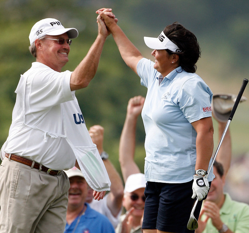 Pat Hurst of the US high-fives her caddie Dan Wilson after making a birdie on the 8th hole during the third round of the US Women's Open Golf Championship at Newport Country Club in Newport Rhode Island, Sunday 2 July 2006