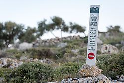 17 April 2019, Tulkarem, West Bank, Occupied Palestinian Territories: Israeli authorities have placed a sign prohibiting access to what is an old burial ground for the local villagers of Yanoun. The village of Yanoun sits on a hillside in the Nablus Governorate of the West Bank. There is only one road into the village, which is otherwise surrounded on all sides by Israeli settlements.