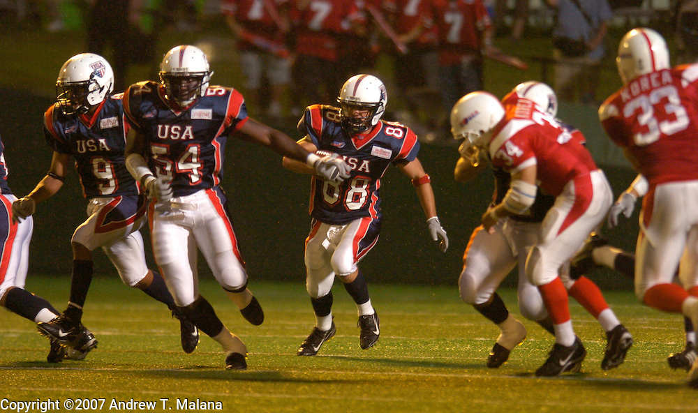 Team USA vs Team Korea:..Bob Awrey returns the opening kickoff for a touchdown against Team Korea at Kawasaki Stadium.