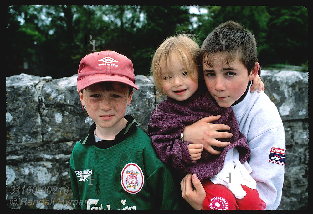 Two boys and a girl pose for picture in village of Cong.  Ireland