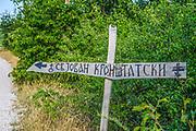 Road sign pointing the way to the Serbian Orthodox St. John of Kronstadt monastery, near the village of Korita, Republika Srpska, Bosnia and Herzegovina.