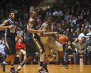 "Ole MIss forward Reginald Buckner (2) dribbles against Penn State forward David Jackson (15) at the C.M. ""Tad"" Smith Coliseum on Friday, November 26, 2010. Ole Miss won 84-71."