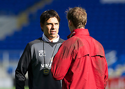CARDIFF, WALES - Monday, October 15, 2012: Wales' manager Chris Coleman chats with goalkeeper Owain Fon Williams during a training session at the Cardiff City Stadium ahead of the Brazil 2014 FIFA World Cup Qualifying Group A match against Croatia. (Pic by David Rawcliffe/Propaganda)