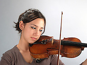 young female violinist playing her violin, studio shot Model released