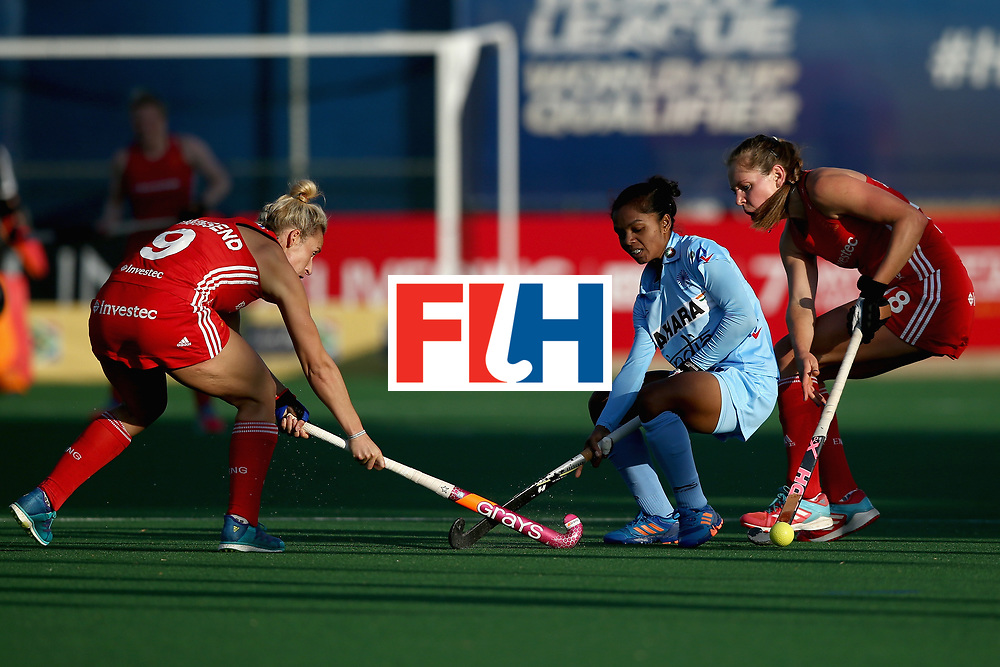 JOHANNESBURG, SOUTH AFRICA - JULY 18:  Anupa Barla of India attempts to keep possesion while under pressure from Giselle Ansley of England (R) and Susannah Townsend of England (L) during the Quarter Final match between England and India during the FIH Hockey World League - Women's Semi Finals on July 18, 2017 in Johannesburg, South Africa.  (Photo by Jan Kruger/Getty Images for FIH)