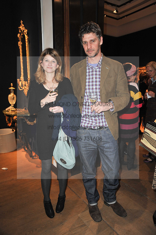 NESTA FITZGERALD and JAMES COOPER at a party to celebrate the publication of The irish Country House written by The Knight of Glin and James Peill with photographs by James Fennell, held at Christie's, King Street, London on 24th January 2011.