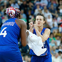 09 August 2012: France Celine Dumerc is congratulated by Isabelle Yacoubou during 81-64 Team France victory over Team Russia, during the women's basketball semi-finals, at the 02 Arena, in London, Great Britain.