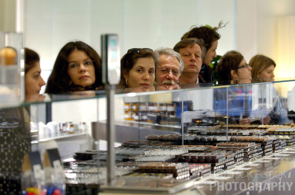 BRUSSELS, BELGIUM - JAN-13-2006 -  A line of customers wait for service at Pierre Marcolini's flag ship chocolate shop on the Grand Sablon in Brussels.  (PHOTO © JOCK FISTICK)