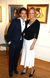 Artist ADRIAN DE JAGER and SALLY ROBERTSON at an exhibition of art by Sam Sopwith held at 27 Cork Street, London W1 on 23rd May 2006.<br />