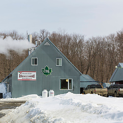 Steam rises from the Rodrique sugarhouse in Big Six Township, Maine.