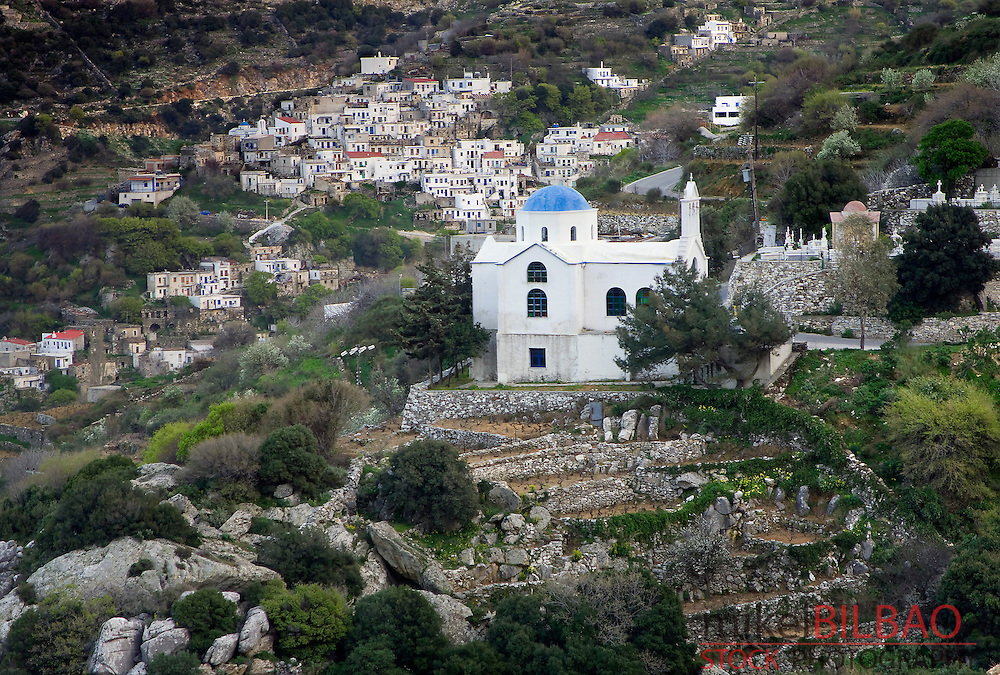 orthodox church and village. Koronos. <br /> Naxos island. Cyclades islands, Aegean Sea, Greece, Europe.