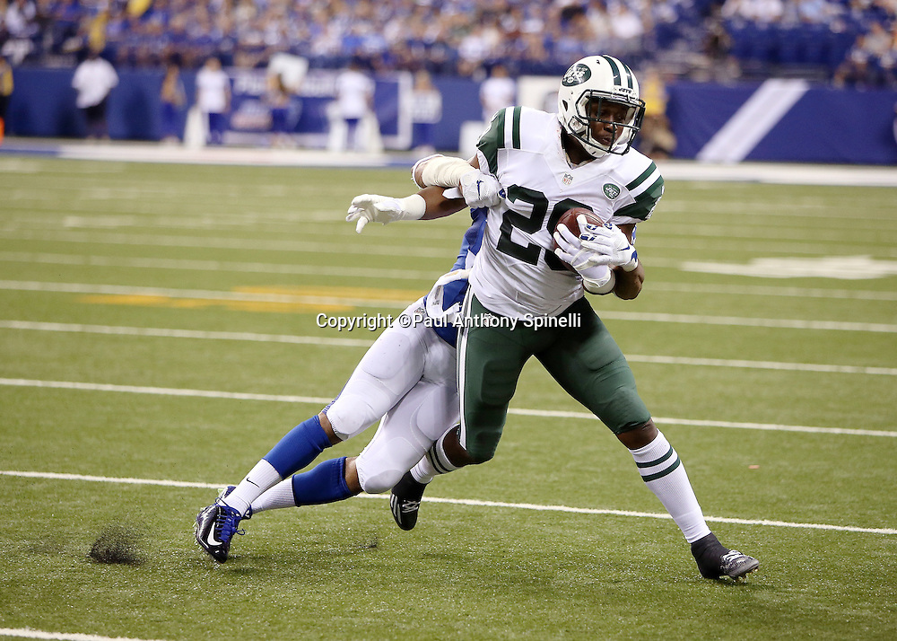 New York Jets running back Bilal Powell (29) gets tackled by Indianapolis Colts free safety Dwight Lowery (33) on a quick out pass pattern late in the second quarter during the 2015 NFL week 2 regular season football game against the Indianapolis Colts on Monday, Sept. 21, 2015 in Indianapolis. The Jets won the game 20-7. (©Paul Anthony Spinelli)