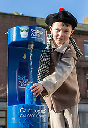 Youngsters paid tribute to one of Dumfries&rsquo; most celebrated former residents when they unveiled a new water refill tap in the town.<br /> <br /> The high tech Top Up Tap has been installed by Scottish Water as part of its national initiative to encourage people to carry a reusable bottle and stay hydrated on the go. <br /> <br /> Pictured: Corey James Lake from Noblehill Primary School who donned an 18th century outfits and recited some poems by Robert Burns.