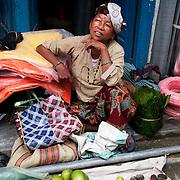 Nepal 2014. Manibanjan. Market day. Woman selling guavas.