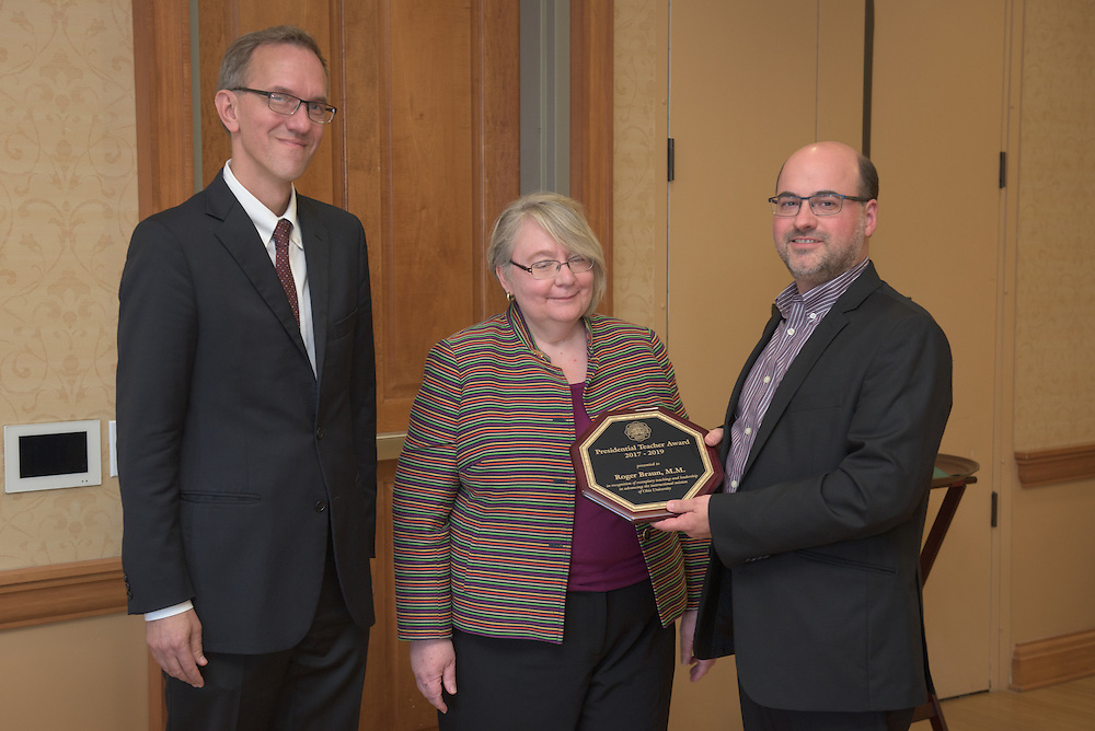 From left: Joseph Shields, Vice President for Research & Creative Activity and Dean of Ohio University's Graduate College along with Pam Benoit, Executive Vice President and Provost, congratulate Roger Braun for being the winner of the Presidential Teacher Award during the 2016 Faculty Awards Recognition Ceremony held at Baker Center on Tuesday, September 6, 2016.