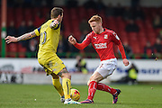 Oxford United Forward, Chris Maguire (10) and Swindon Town Defender, James Brophy (11) during the EFL Sky Bet League 1 match between Swindon Town and Oxford United at the County Ground, Swindon, England on 5 February 2017. Photo by Adam Rivers.
