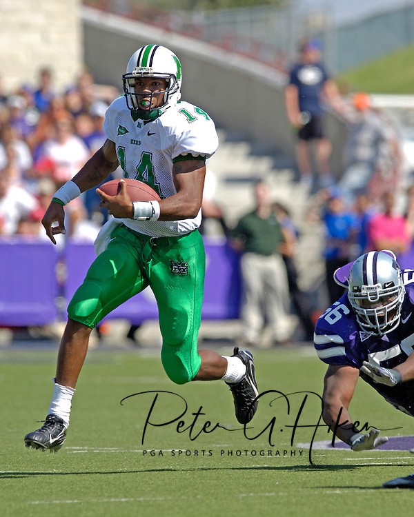 Marshall quarterback Bernard Morris (14) rushes past Kansas State nose tackle Quintin Echols (56) in the first half, at Bill Snyder Family Stadium in Manhattan, Kansas, September 16, 2006.  The Wildcats beat the Thundering Herd 23-7.