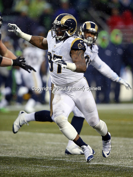 St. Louis Rams defensive end Eugene Sims (97) rushes during the 2015 NFL week 16 regular season football game against the Seattle Seahawks on Sunday, Dec. 27, 2015 in Seattle. The Rams won the game 23-17. (©Paul Anthony Spinelli)