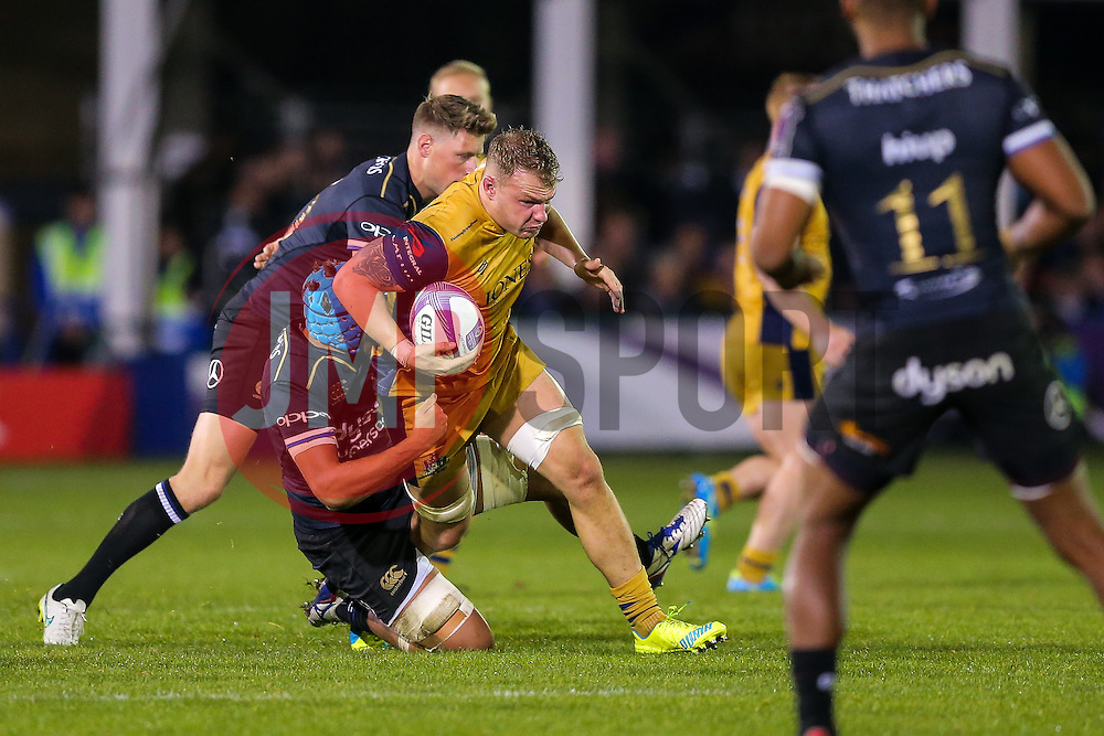 Mitch Eadie of Bristol Rugby is tackled by Zach Mercer and Rhys Priestland of Bath Rugby - Rogan Thomson/JMP - 20/10/2016 - RUGBY UNION - The Recreation Ground - Bath, England - Bath Rugby v Bristol Rugby - EPCR Challenge Cup.