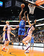 Jan. 14, 2013; Phoenix, AZ, USA; Oklahoma City Thunder center Hasheem Thabeet (34) goes up with the ball during the game against the Phoenix Suns center Marcin Gortat (4) and forward Luis Scola (14) in the first half at US Airways Center. The Thunder defeated the Suns 102-90. Mandatory Credit: Jennifer Stewart-USA TODAY Sports..