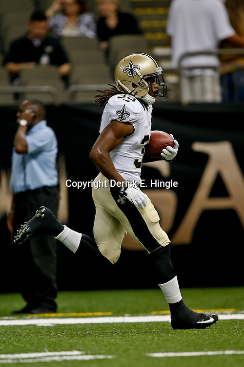Aug 9, 2013; New Orleans, LA, USA; New Orleans Saints running back Travaris Cadet (39) against the Kansas City Chiefs during a preseason game at the Mercedes-Benz Superdome. The Saints defeated the Chiefs 17-13. Mandatory Credit: Derick E. Hingle-USA TODAY Sports