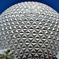 Spaceship Earth Close Up at Epcot in Orlando, Florida<br /> Spaceship Earth is a giant geodesic sphere with over 11,000 isosceles triangles. The 18 story dome is the symbol of Epcot. The outside of its steel shell is covered with 954 panels. Inside is a 15 minute narrated ride tracing the history of communications from prehistoric man through the computer age.  It is a fun attraction.  Sadly, it did not teach me how to use the apps on my smart phone.