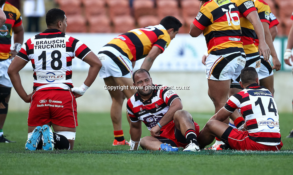 Counties Maukau players sit dejected after losing the ITM Cup rugby match - Waikato v Counties Manukau at Waikato Stadium, Hamilton on Sunday 14 September 2014.  Photo: Bruce Lim / www.photosport.co.nz