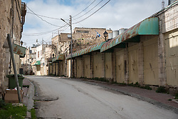 2 March 2020, Hebron: The Al-Shuhada Street in the H2 area of Hebron. The area is under Israeli military control, and following the 1994 massacre at the Tomb of the Patriarchs (known to the Muslims as Al-Ibrahimi Mosque and to the Jews as Cave of Machpelah) all the Palestinian shops on Shuhada street have been closed, turning the street into a virtual ghost town.