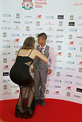 LIVERPOOL, ENGLAND - Thursday, May 12, 2016: Jude Cisse and son Cassius arrive on the red carpet for the Liverpool FC Players' Awards Dinner 2016 at the Liverpool Arena. (Pic by David Rawcliffe/Propaganda)