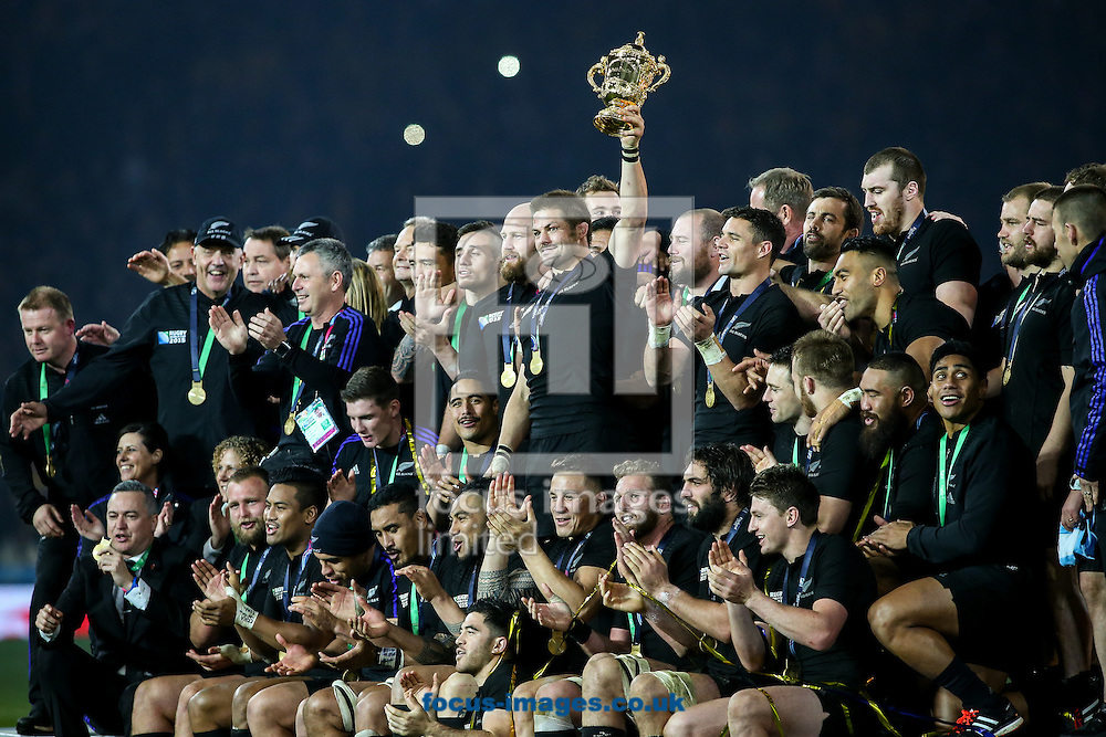 Richie McCaw of New Zealand (centre) holds the World Cup trophy aloft after the final of the 2015 Rugby World Cup at Twickenham Stadium, Twickenham<br /> Picture by Andy Kearns/Focus Images Ltd 0781 864 4264<br /> 31/10/2015