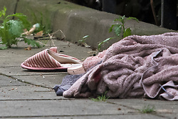 © Licensed to London News Pictures. 26/07/2019. London, UK. Personal belongings, including a slipper,  lie on the floor at the scene at Boundary Road in South Hampstead, north west London where a man has died and another was injured in a stabbing last night.  Photo credit: Ben Cawthra/LNP