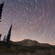 Polaris the north star hangs in the night sky as other stars swirl overhead during a long exposure taken at the base of the Shastina portion of Mt Shasta. Shasta County, CA