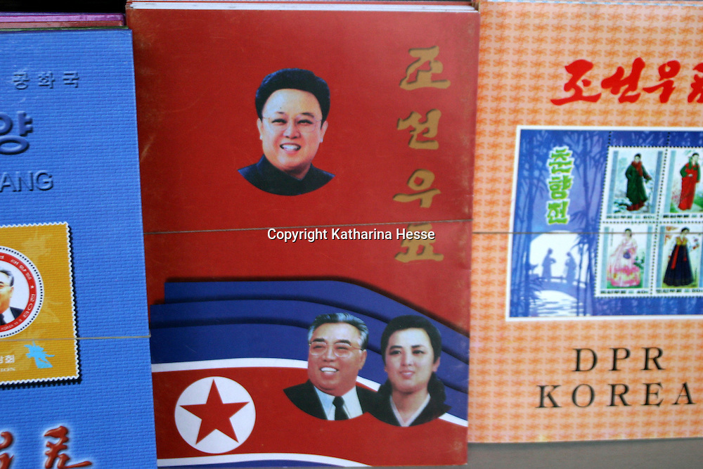 NORTHERN CHINA-APRIL 25:  Books and stamps of the North Korean leadership are displayed in a store on April 24, 2004 in Dandong, China. On April 22, 2004 at least 154 people died and more than 1300 were injured following a train explosion in Ryonchon, a North Korean town 20 km from the Dandong border. China has vowed to give North Korea $1.21 million worth of medical supplies, tents and food to help it cope with the disaster