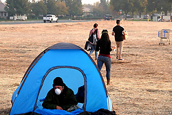 CHICO, Nov. 19, 2018  A victim of the Camp Fire rests in a tent at the parking area of Walmart in Chico of Butte County, California, the United States, Nov. 18, 2018. The death toll from the massive wildfire in Northern California, dubbed the Camp Fire, has climbed to 77, said authorities on Sunday evening.  wsw) (Credit Image: © Wu Xiaoling/Xinhua via ZUMA Wire)