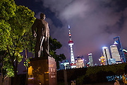 Statue of Shanghai Mayor Chen Yi on the Bund at night in Shanghai, China.